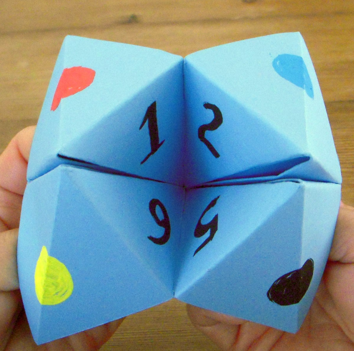 Make a paper cootie catcher and play the fortune telling game.