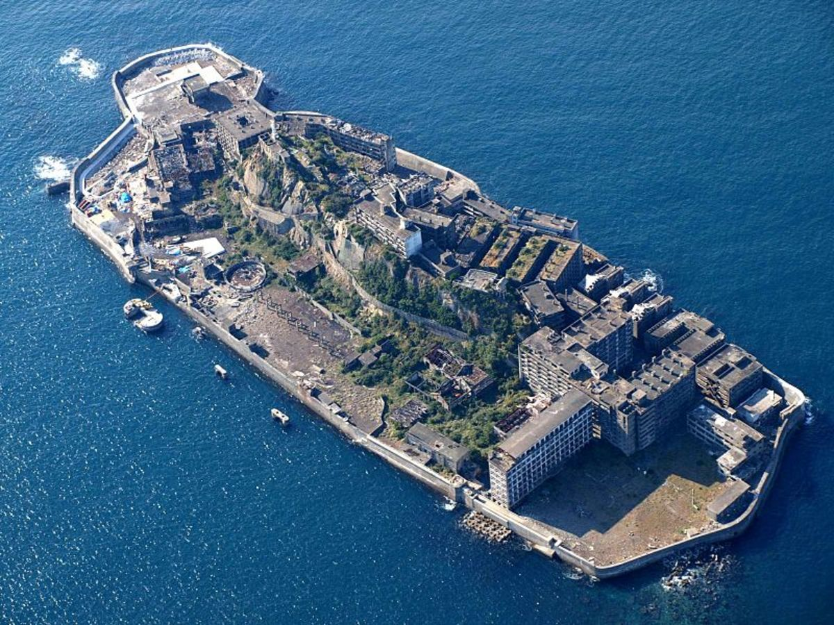 Hashima Island in Japan is a floating ghost town.
