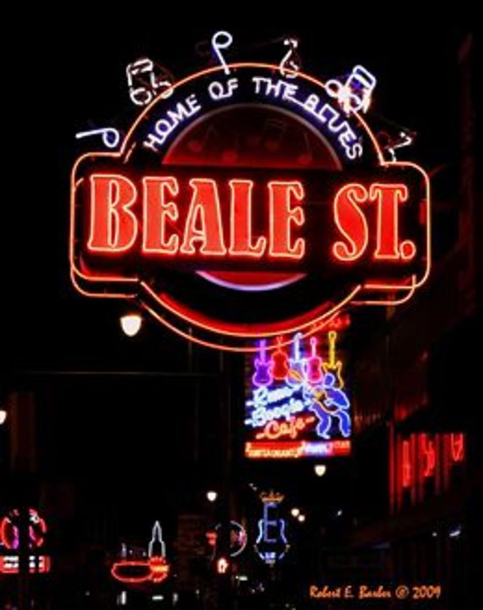 The lights shining on Beale Street showing all of the nighttime fun.