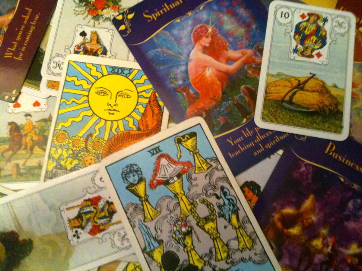 Tarot, Lenormand and Oracle cards. Each has its own system for divination.