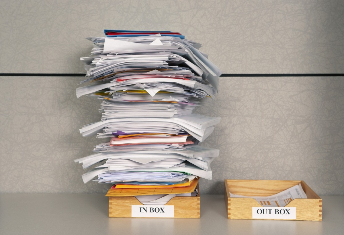 Wouldn't it be nice if your Inbox could look like the paper pile on the right, not the one on the left? Here's how to start sorting through your email.