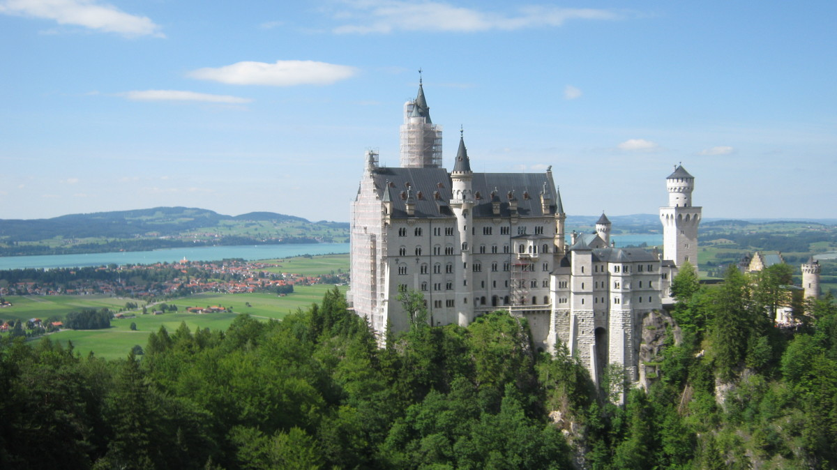 Neuschwanstein Castle is surrounded by beautiful countryside. This fairytale castle is said to have inspired Disney's logo.