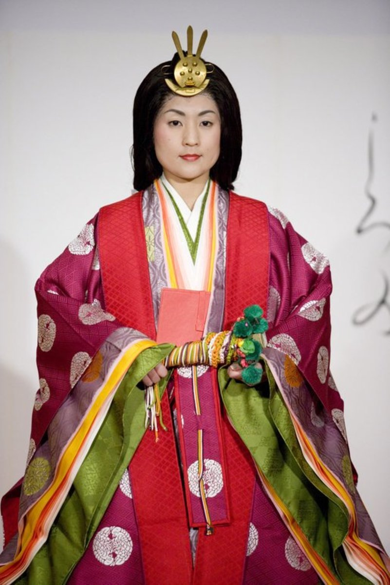 The woman pictured is modeling a Junihitoe kimono, which was the traditional item of dress for women of the Heian court.