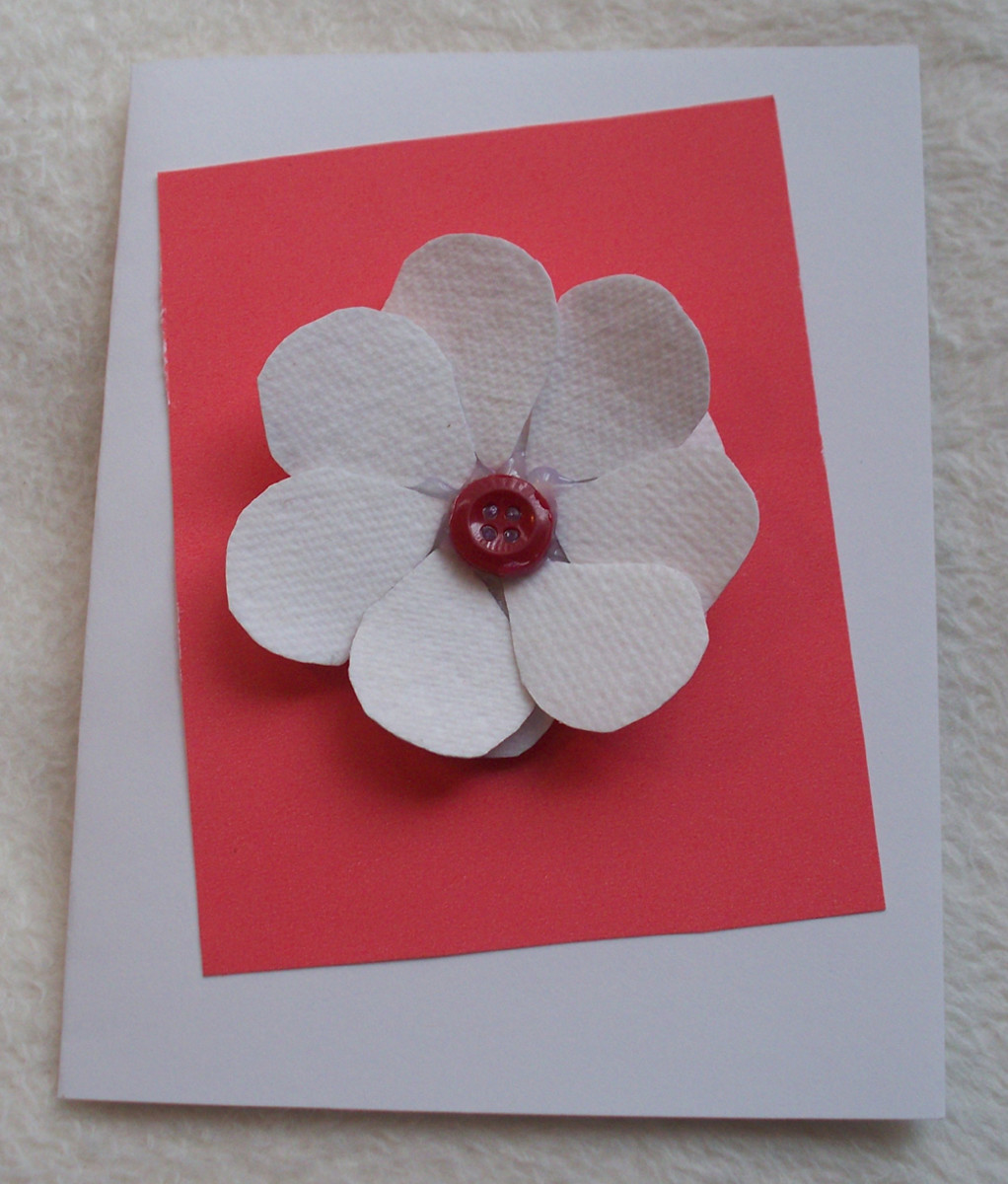 A paper towel flower decoration for the front of a card