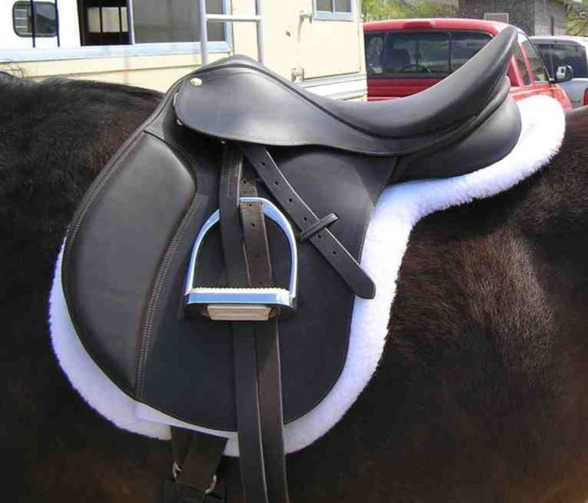 Safely rolled up stirrup leathers. This keeps the stirrups out of the way so that they are less likely to catch on anything