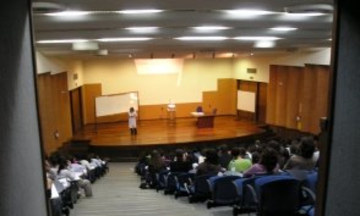 Professor in front of a seminar-style classroom