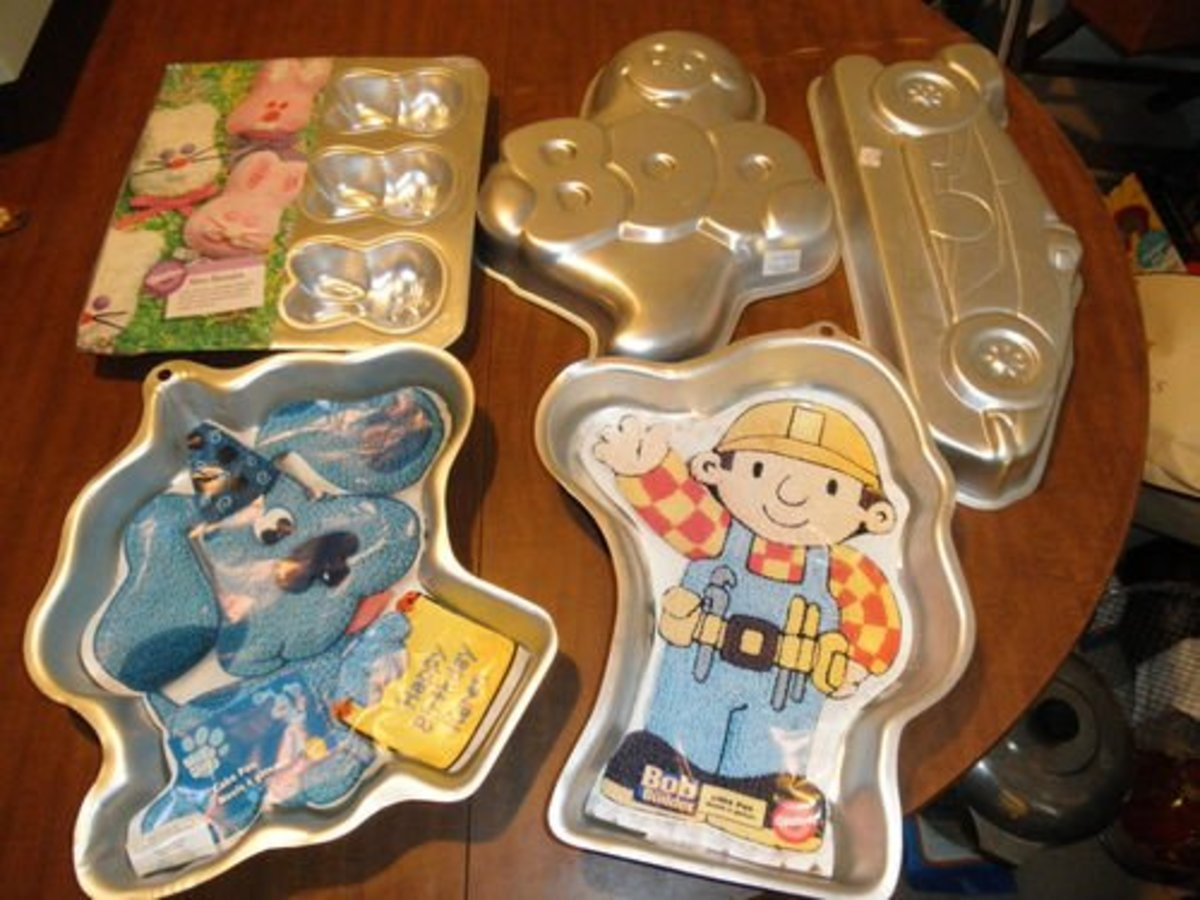 Here is a nice lot of Wilton Cake pans. The inserts make them worth more.