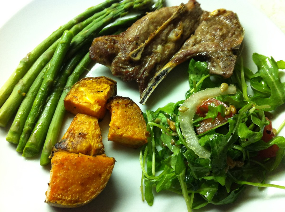 Broiled lamb shoulder chops with asparagus, roasted sweet potatoes, and an arugula salad