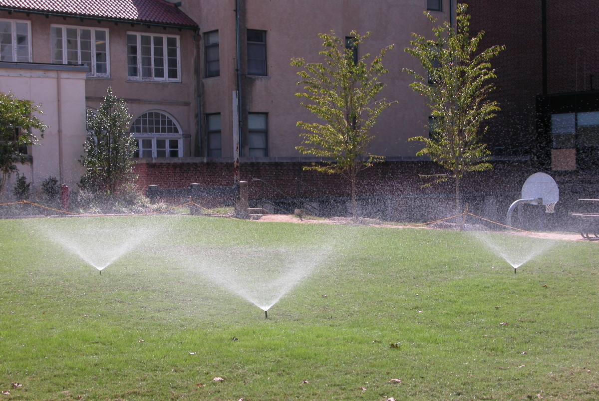 Properly working sprinkler systems keep grass green.