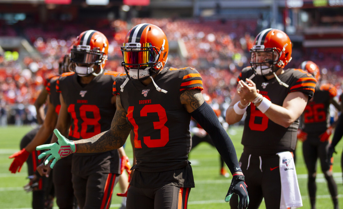 Sep 8, 2019; Cleveland, OH, USA; Cleveland Browns wide recievers Odell Beckham (13) and Damion Ratley (18) along with quarterback Baker Mayfield (6) welcome teammates onto the field before a game against the Tennessee Titans at FirstEnergy Stadium.