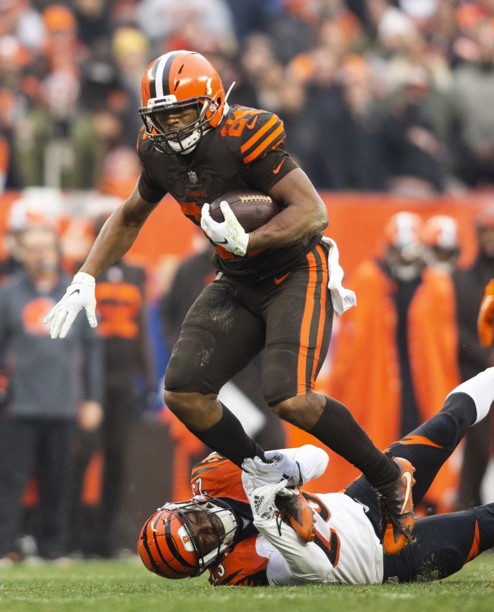 Dec 23, 2018; Cleveland, OH, USA; Cleveland Browns running back Nick Chubb (24) breaks a tackle from Cincinnati Bengals cornerback Darius Phillips (23) during the third quarter at FirstEnergy Stadium.