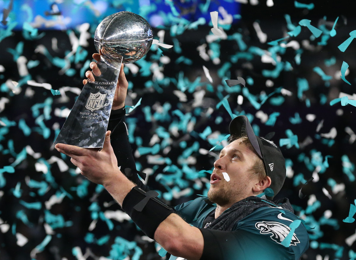 Feb 4, 2018; Minneapolis, MN, USA; Philadelphia Eagles quarterback Nick Foles (9) hoist the Vince Lombardi Trophy after a victory against the New England Patriots in Super Bowl LII at U.S. Bank Stadium.