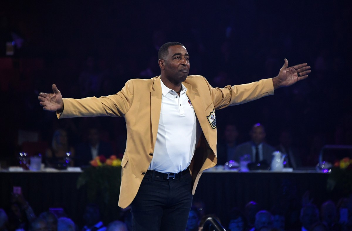 Cris Carter reacts during the Enshrinees Gold Jacket dinner at Memorial Civic Center and Cultural Center.