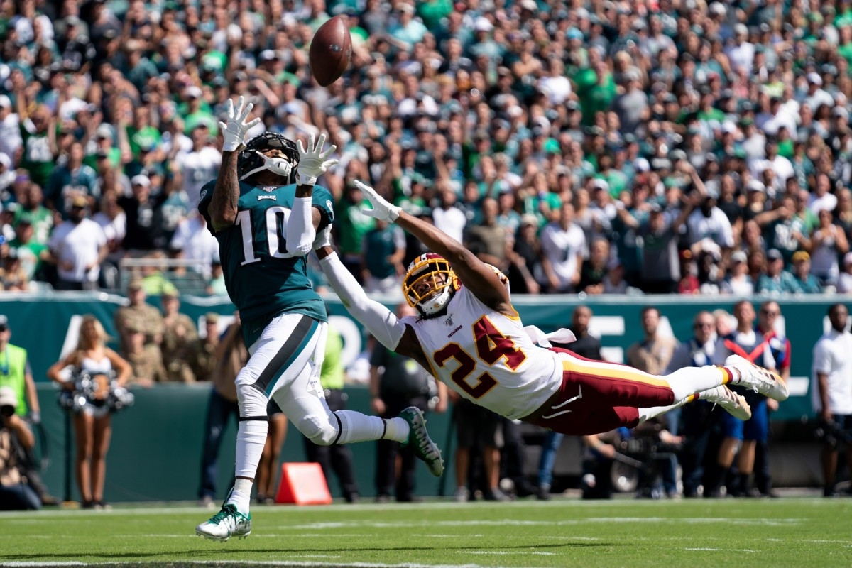 Philadelphia wide receiver DeSean Jackson (10) makes a 51 yard touchdown reception past Washington cornerback Josh Norman (24) during the second quarter at Lincoln Financial Field.