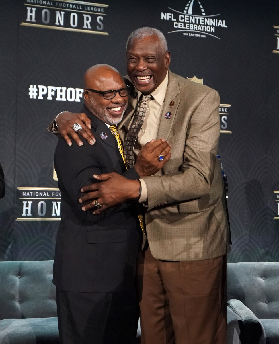 Donnie Shell (left) and Harold Carmichael embrace after being selected to the Pro Football Hall of Fame 2020 Centennial Class during the NFL Honors awards presentation at Adrienne Arsht Center.