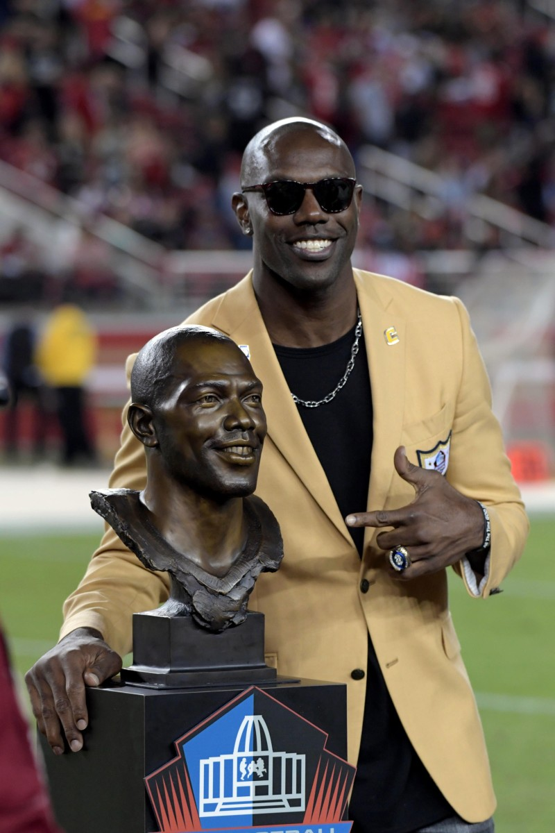 49ers former player Terrell Owens smiles after hall being honored in the hall of Fame induction during the half time presentation at Levi's Stadium.