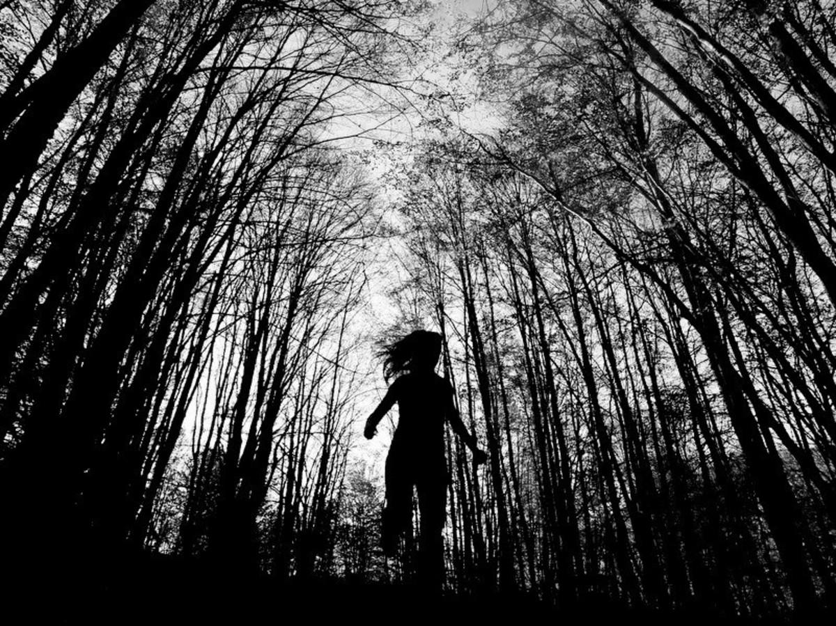 Scared girl running in the dark