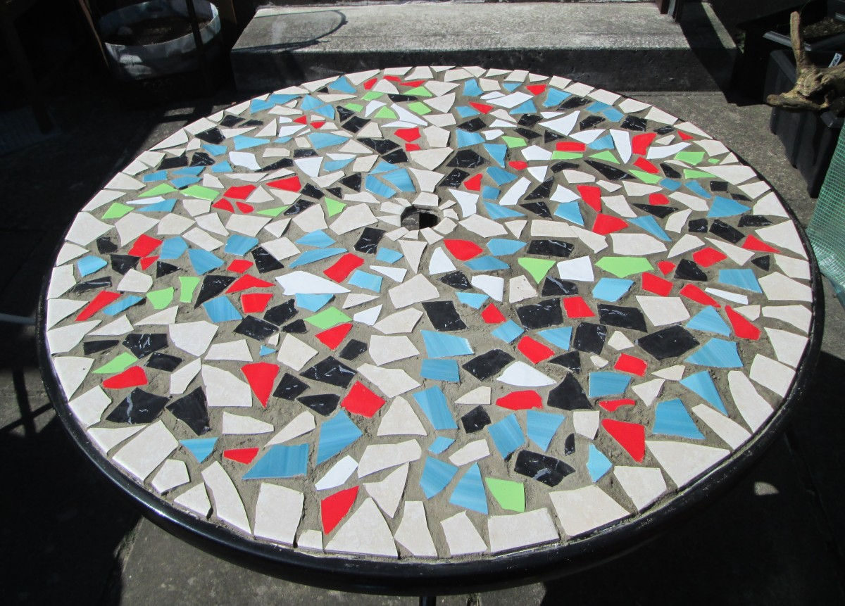 Learn how to make a Mosaic Design with ceramic tiles for a garden table.