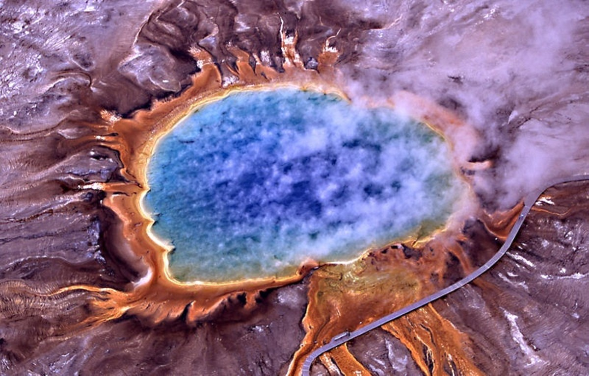 Grand Prismatic Spring, Yellowstone National Park: the orange area is made of thermophilic microbes which contain orange pigments called carotenoids.