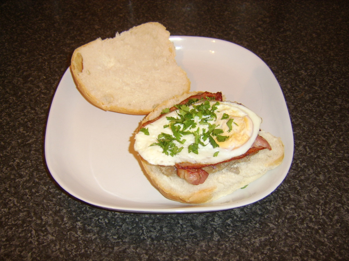 Steak, bacon and fried egg burger style sandwich