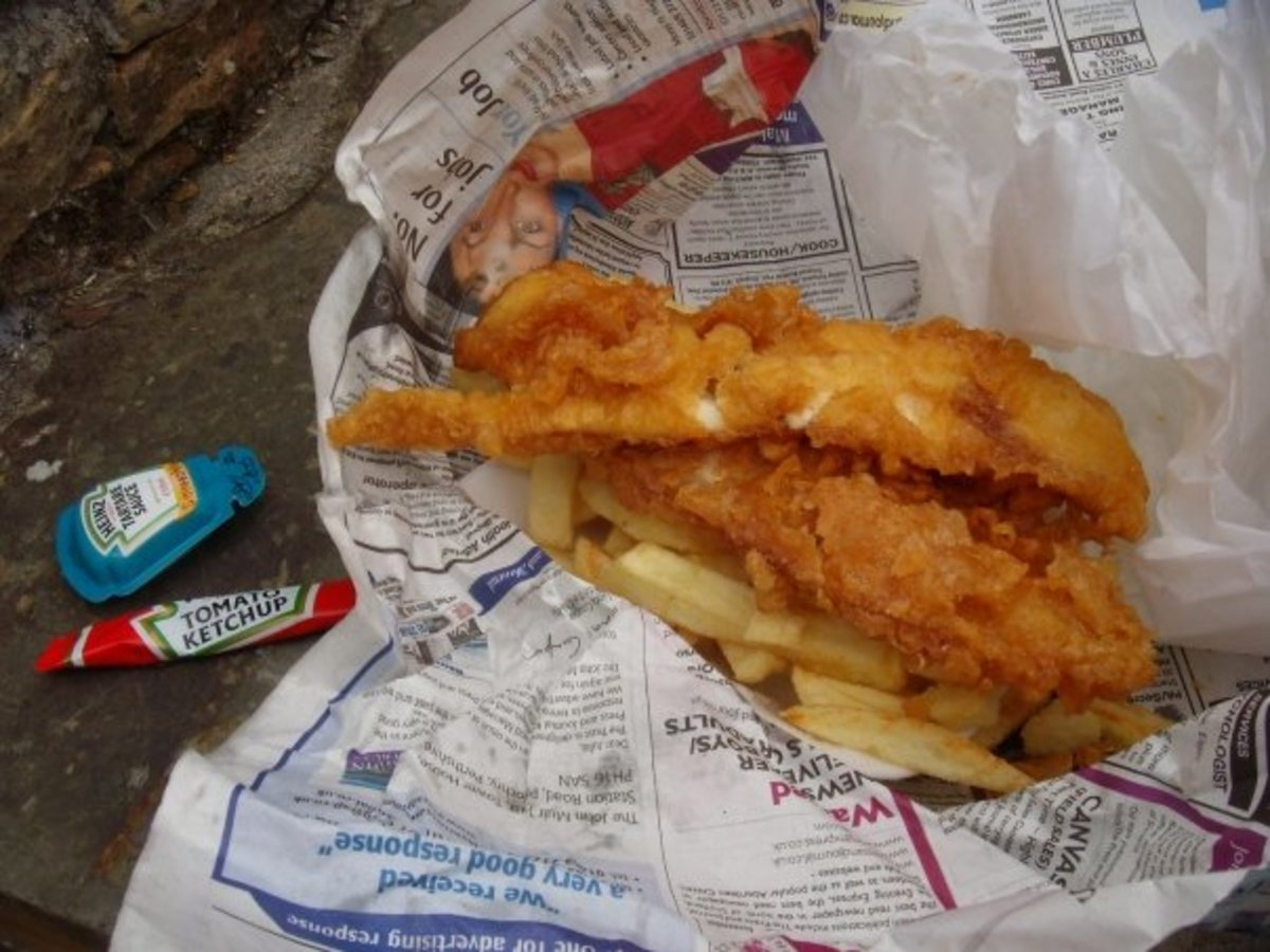 Fish and chips traditionally wrapped in white paper and newspaper.
