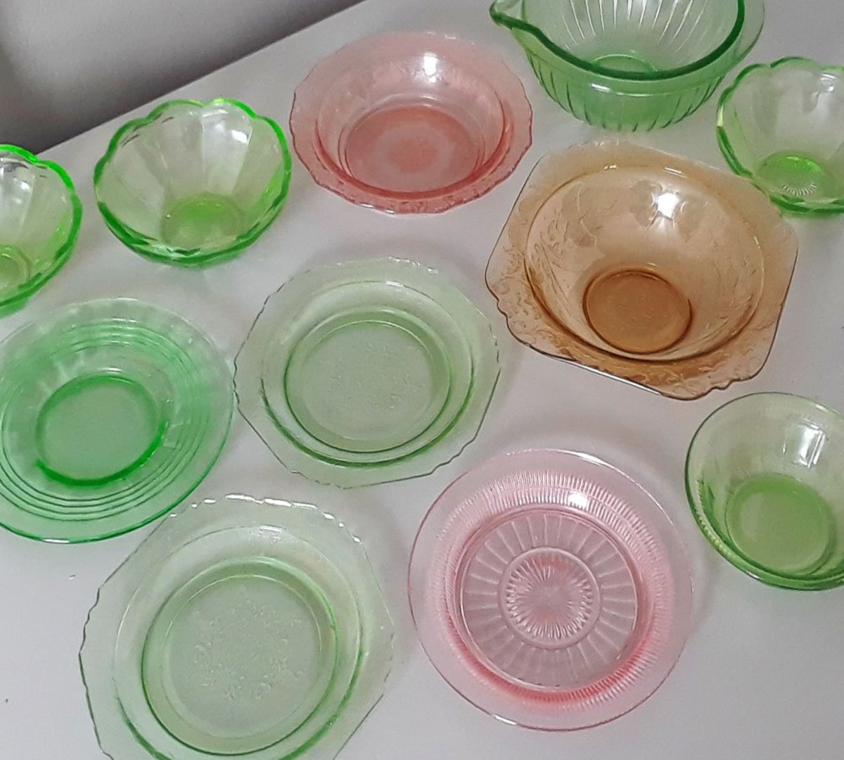Depression glass in a variety of patterns and colors