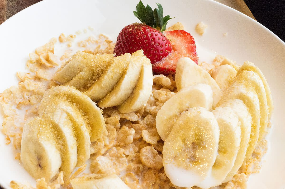 Cereal and bananas with strawberries.