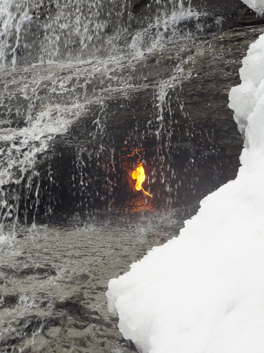 This natural flame burns behind this waterfall in Chestnut Ridge Park.