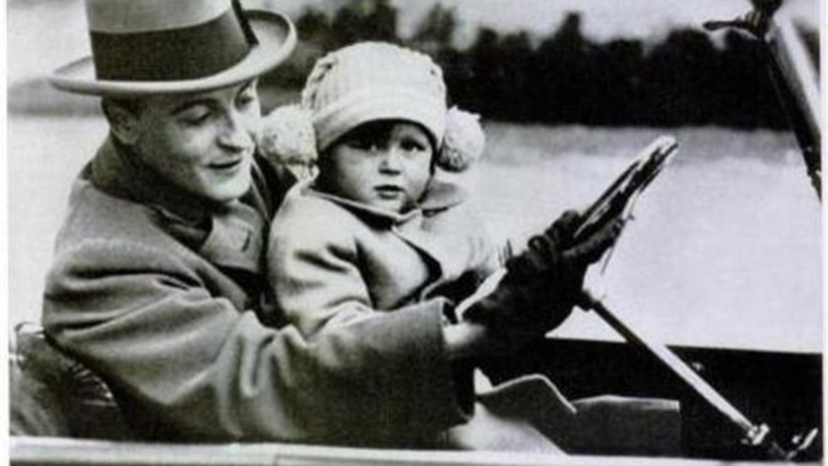 "F. Scott Fitzgerald with only daughter, ""Scottie."""