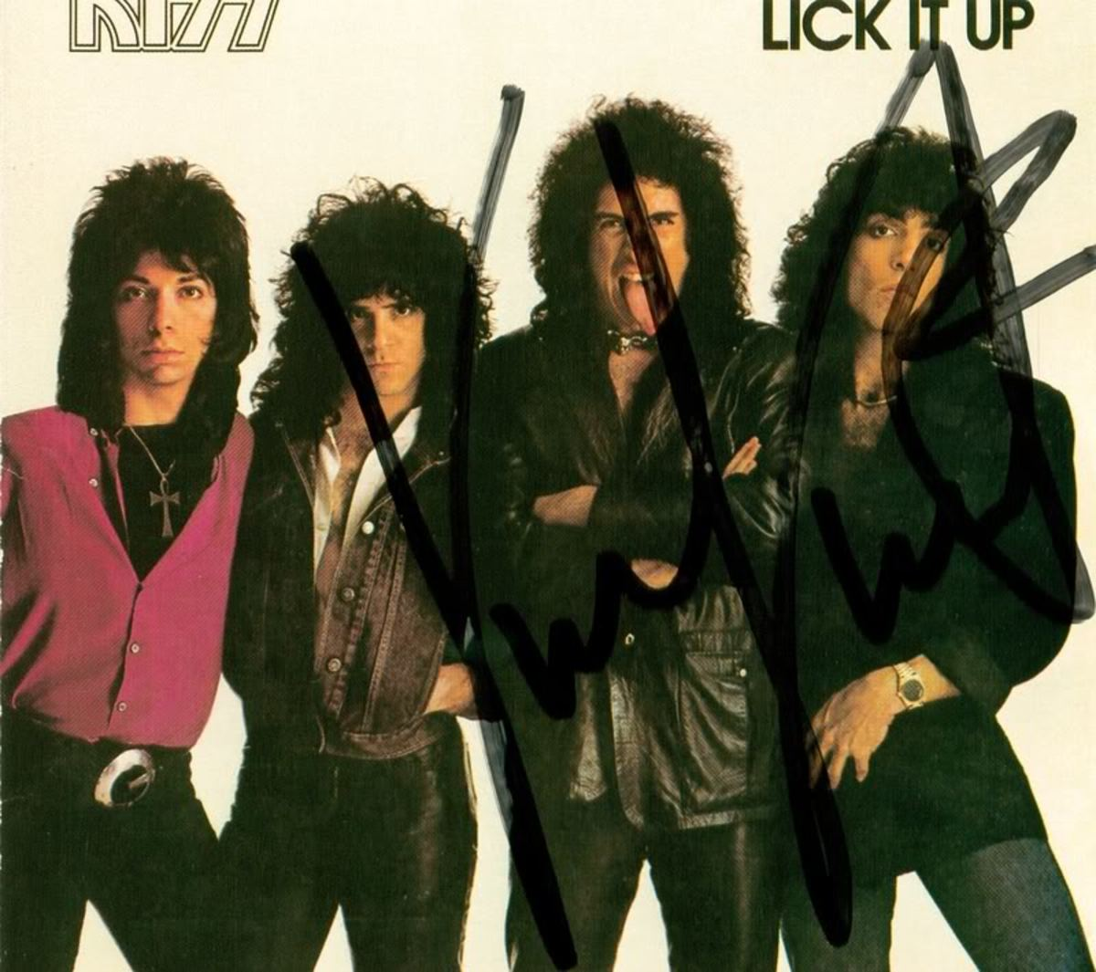 "Author's personal CD of ""Lick It Up,"" autographed by Vinnie Vincent at the 1995 New Jersey KISS Expo. Note that he wrote his signature across everyone else's faces besides his own. Vinnie obviously still has some ""issues"" he needs to work out."