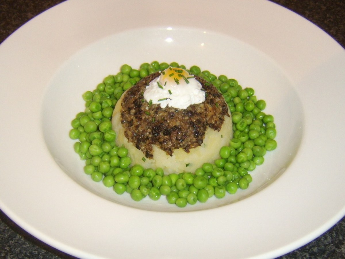 Poached Scottish quail egg on traditional haggis and clapshot