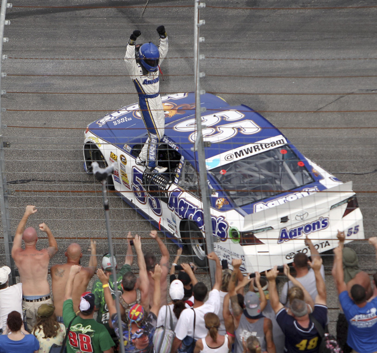 Brian Vickers celebrates with the fans after winning in New Hampshire