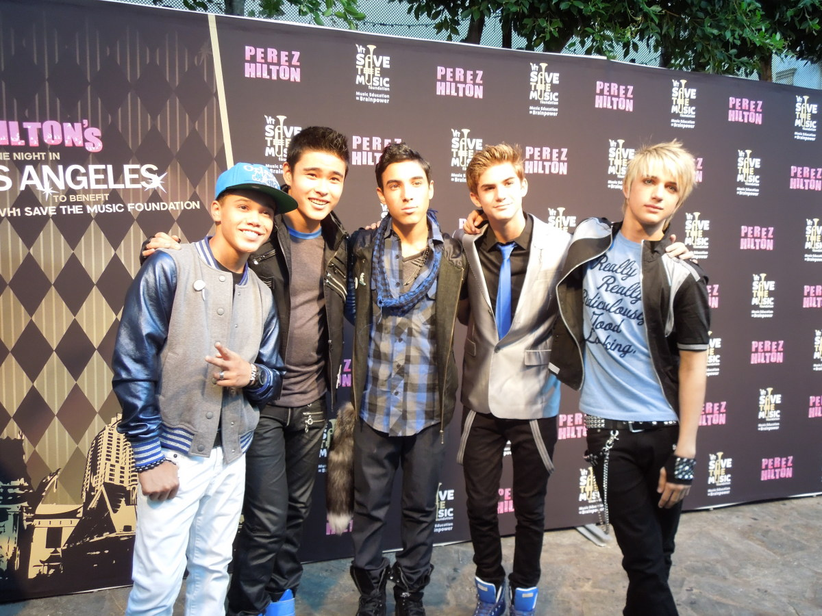 The original members of IM5 strike a pose.