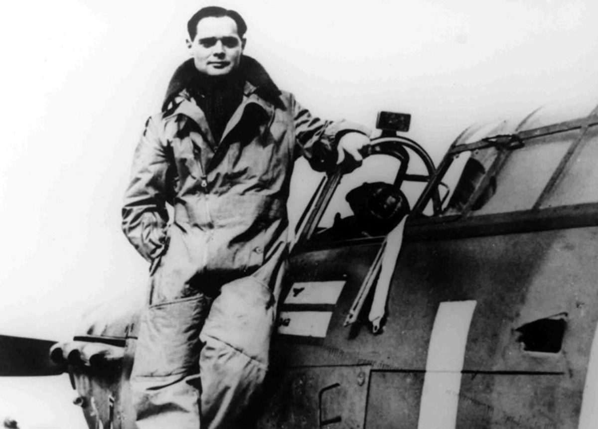 WW2: Douglas Bader stands on the wing of his Hurricane, as Commanding Officer of No.242 Squadron. 1940.