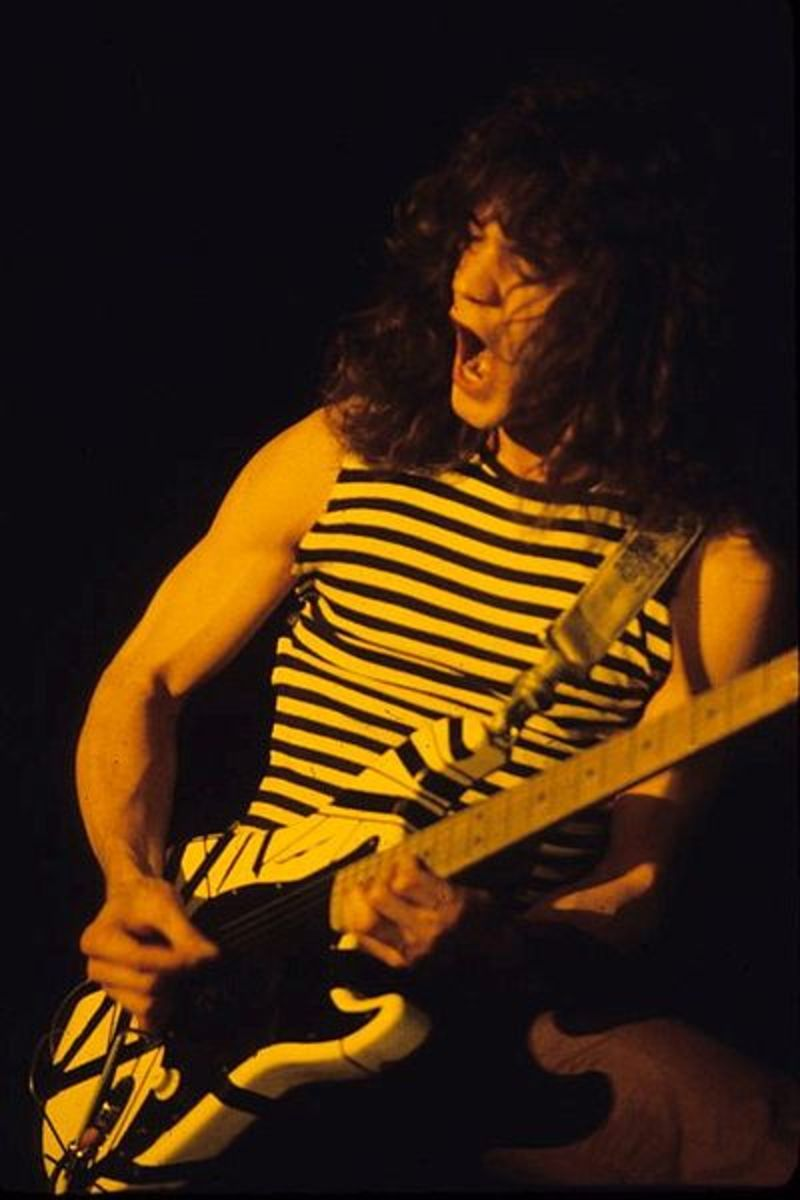Eddie Van Halen plays mind-blowing solos as well as holds down rhythm guitar duties.
