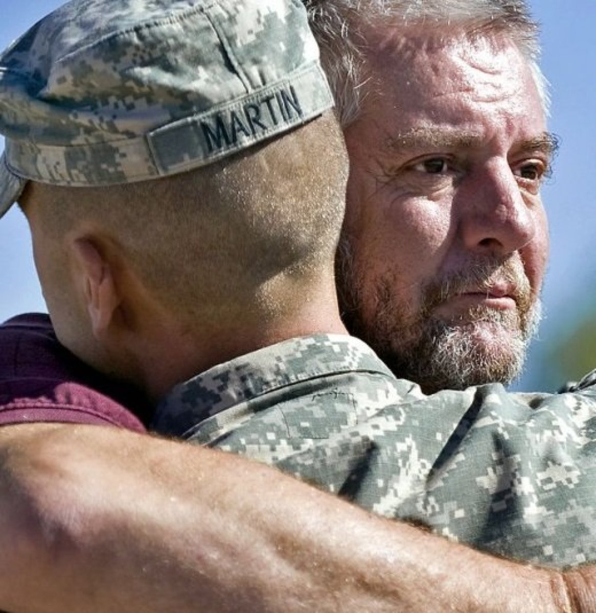 Father hugs his soldier son before his deployment.  Credit:  John Crosby