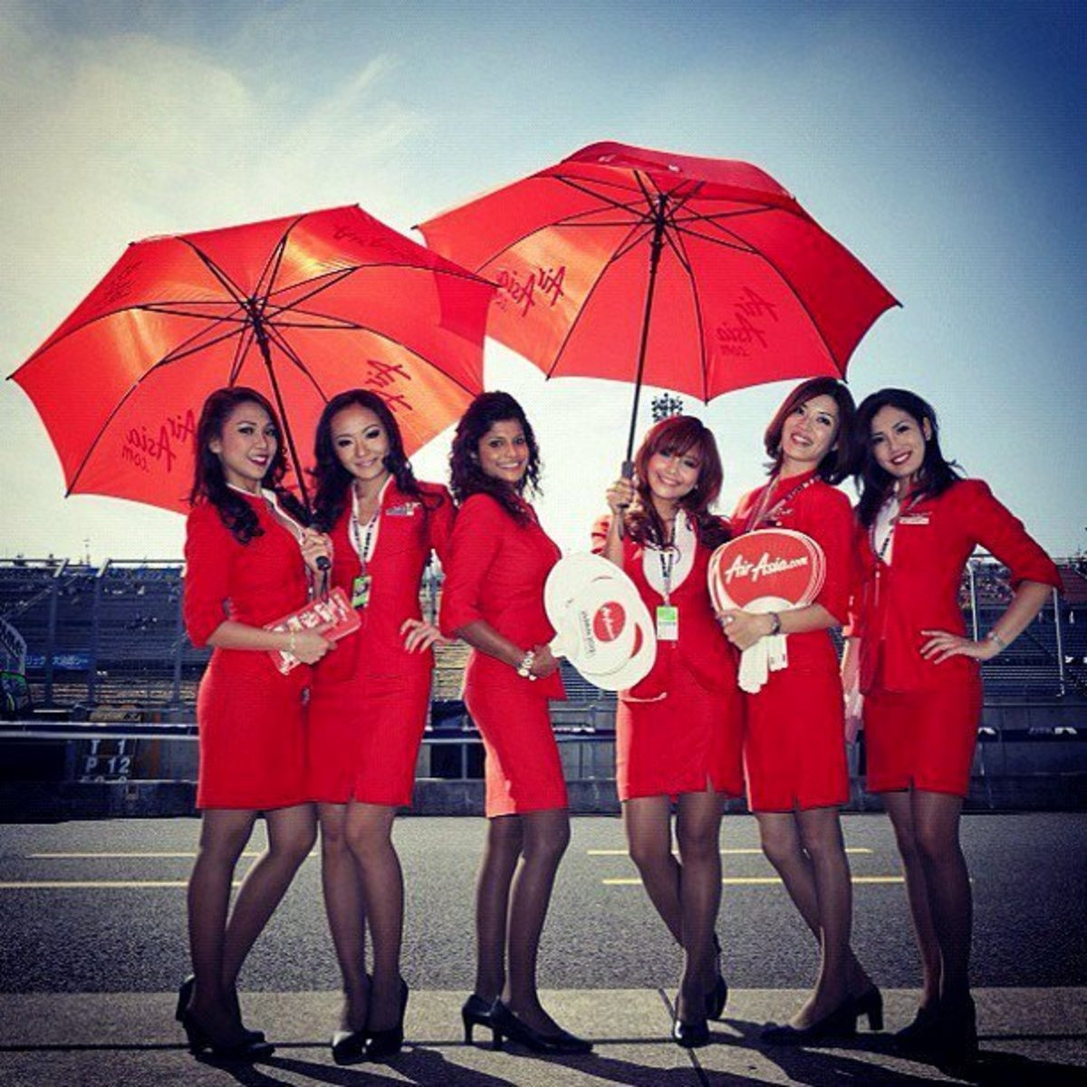 Air Asia flight attendants in their striking red colored uniforms