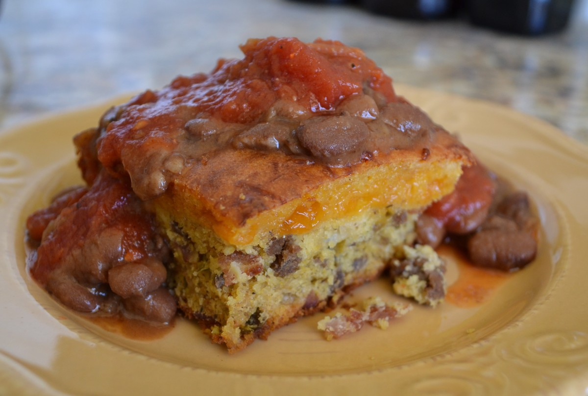 Mexican corn bread casserole smothered in pinto beans and fresh salsa.