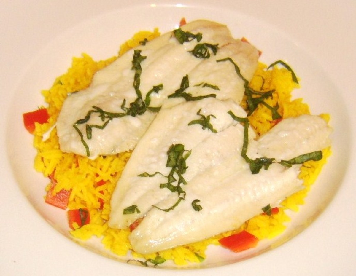 Pan fried plaice fillets on a bed of spicy rice