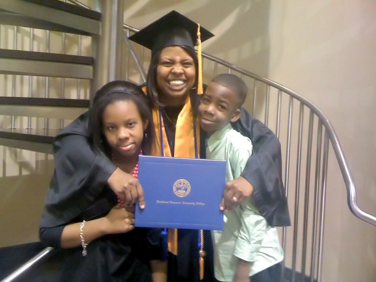 Happy graduate shares a moment with her children.