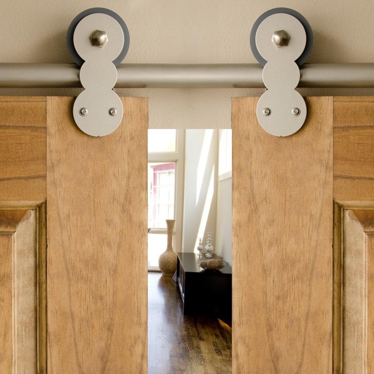 Double rolling barn door hardware