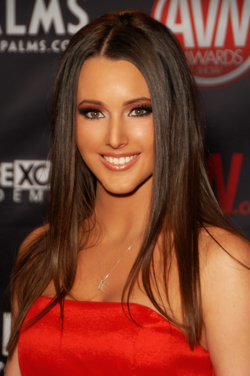 Pin straight chestnut brown hair color with a tan