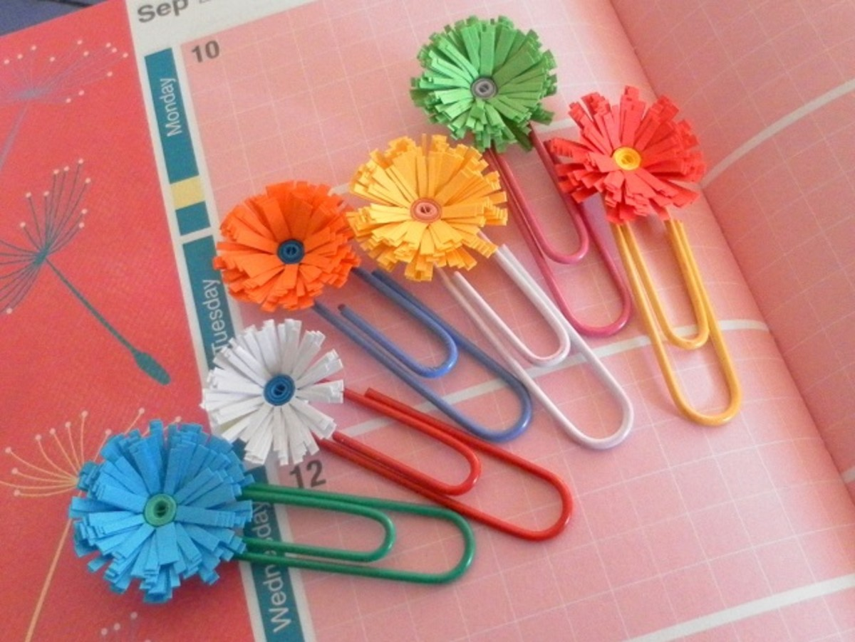 Fringed flowers on paper clips.