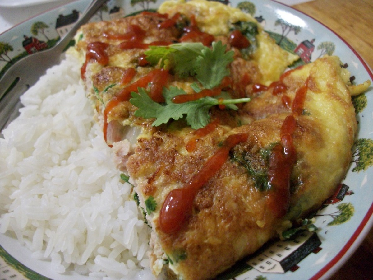 Thai omelette (kai jeow moo sub) served with steamed rice