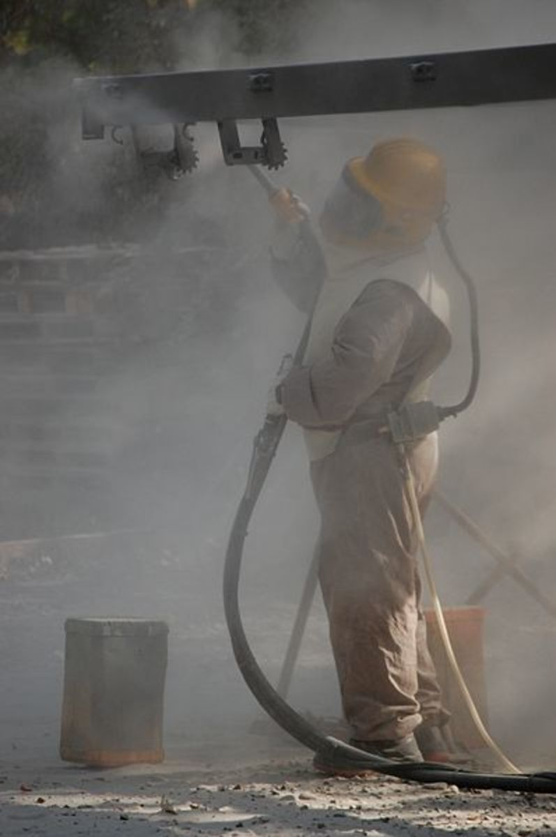 Sandblasting requires the full use of protective clothing to reduce the risk of contracting silicosis.