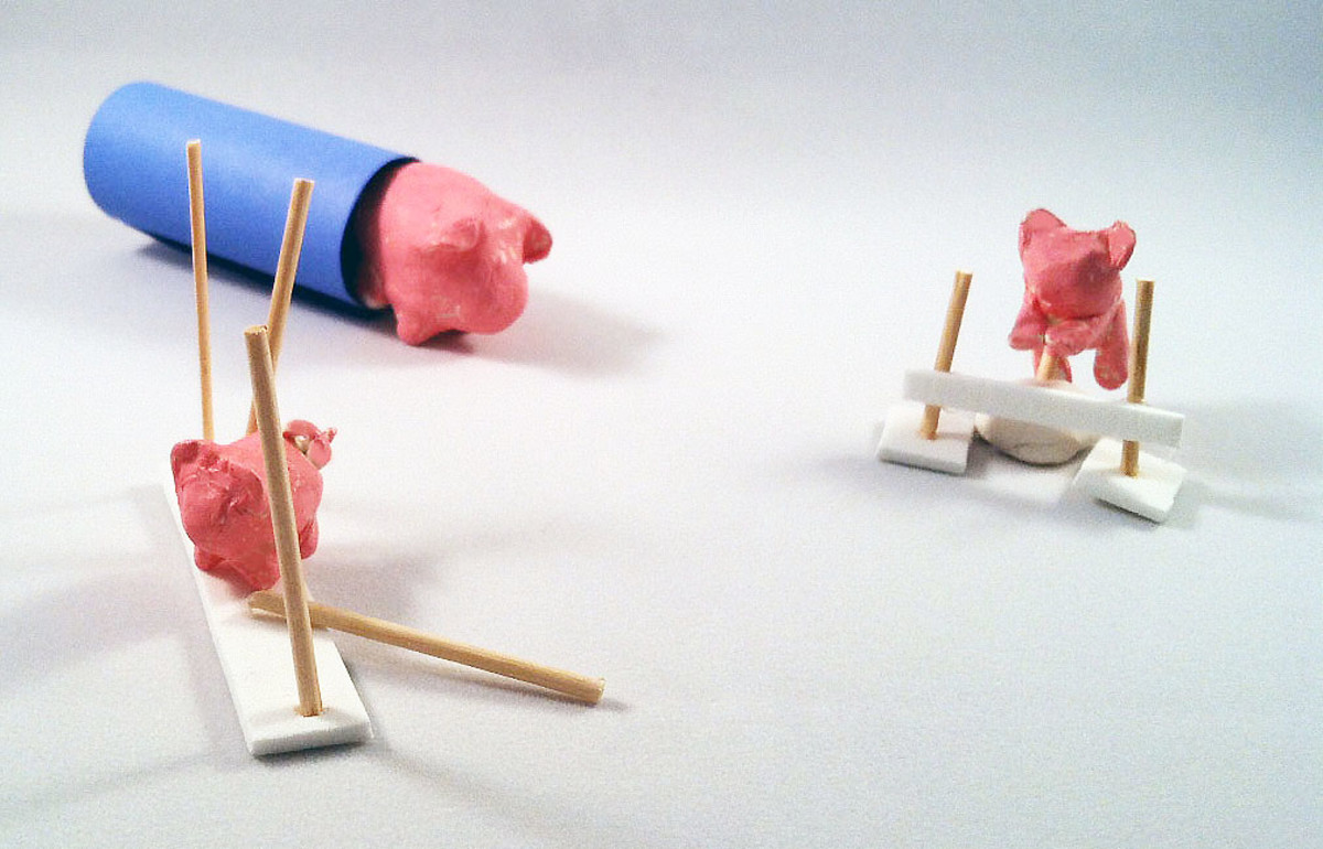 Miniature pigs made from Crayola Air-Dry Clay doing agility