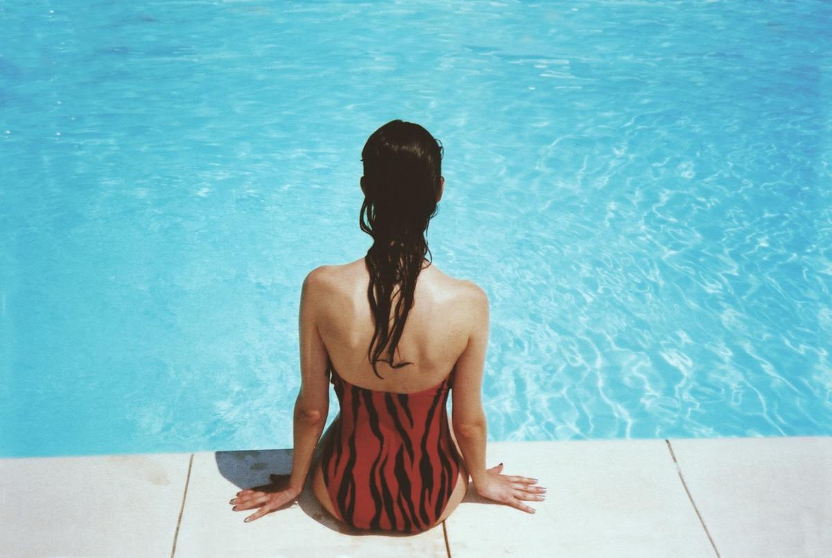 Your period doesn't disappear while you're in the water, but you can still go swimming.