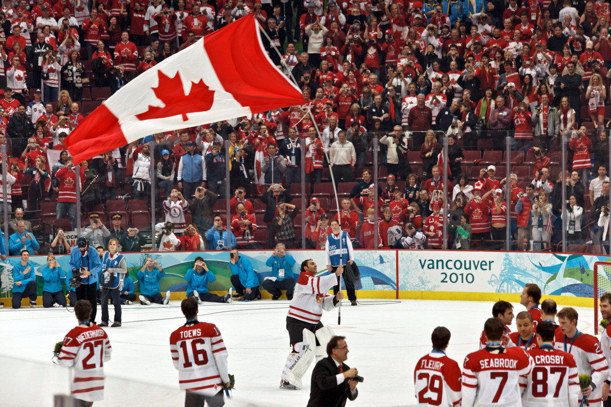 You don't have to be Canadian to be a hockey fan. Team and fans after Team Canada wins gold at the 2010 Olympics.