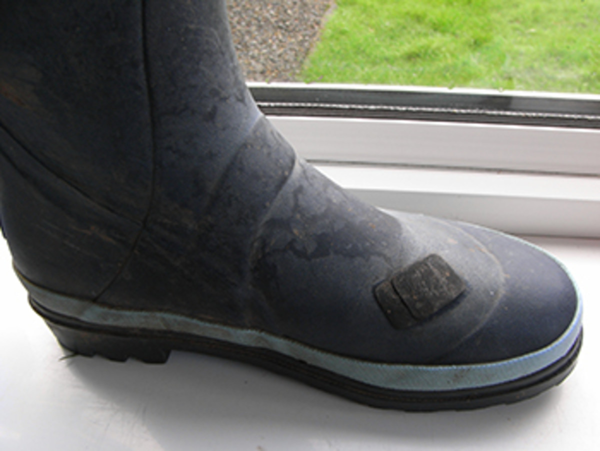 A wellington boot repaired using a puncture repair kit. As you can see this one has been repaired twice already.