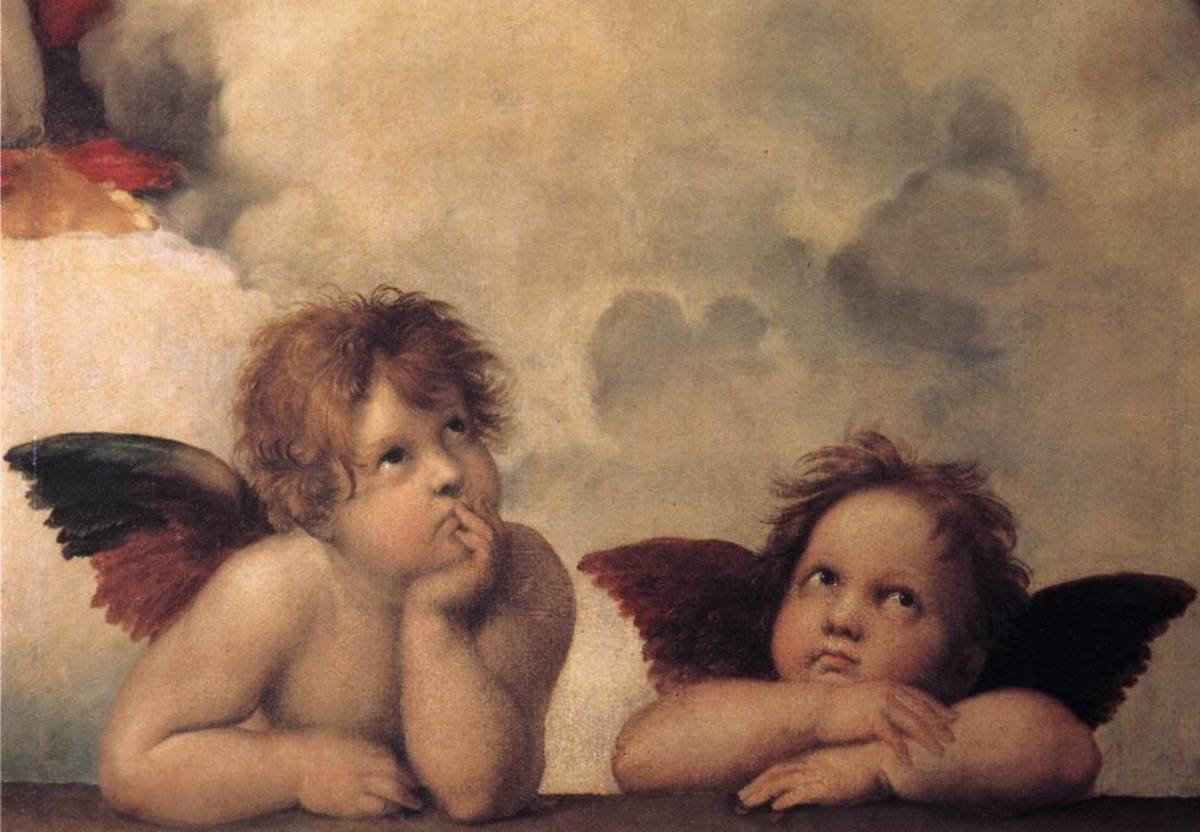 Beautiful cherub angles painted by Raphael on the Sistine Chapel walls.